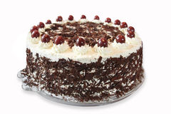 Black forest cake. Traditional black forest cake with whipped creme, chocolate and cherries Royalty Free Stock Images