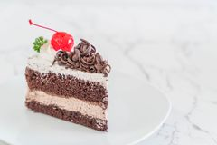 Black forest cake on  plate. Black forest cake on white plate Royalty Free Stock Photos
