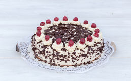 Black Forest cake on white wooden Stock Images