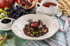 Black Forest chocolate dessert with cup of tea on textile napkin. Side view stock photography