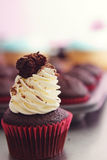 Black forest cupcake with blurred tray in background Stock Photo