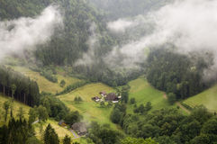 Black forest farm house. A black forest farm house in a valley Stock Images