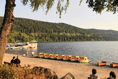 Black Forest, Lake Titisee Beach with Rental Boats and Tourists royalty free stock images