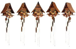 Black forest's cuckoo clock (different angles). Black forest's mechanical wooden cuckoo clock (set from different angles) isolated on white background Royalty Free Stock Photo