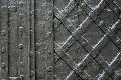 Black forged iron door for texture or background, ancient architecture of castle gate backdrop Royalty Free Stock Image