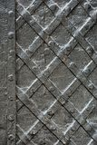 Black forged iron door for texture or background, ancient architecture of castle gate backdrop royalty free stock images