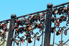 Black forged railings with many wedding locks Royalty Free Stock Images
