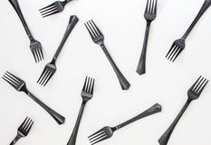 Black forks on a white background. Minimal concept. Abstract. Kitchen plastic disposable accessories picnic table design lunch party colorful red creative funny royalty free stock photography