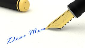 Black fountain pen writing the words dear mom Royalty Free Stock Photo