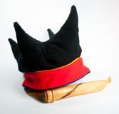 Black four winds hat with knife. A traditional Saami (Lapp) is shown together with a hunting knife from Lappland.  The knife shows the wear and stains of heavy Royalty Free Stock Image