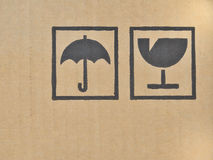 Black fragile symbol on cardboard. Stock Photos