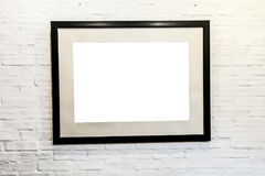 Black frame with blank space on brick wall. Royalty Free Stock Photo