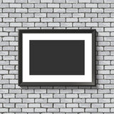 Black frame on brick wall. Stock Photography
