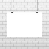 Black frame on brick wall. Empty white A4 sized vector paper mockup hanging with paper clips. Realistic horizontal poster mock-up isolated on white brick wall Royalty Free Stock Image