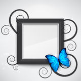 Black frame. Dark empty frame on the wall with a bright blue butterfly on it. EPS10 vector background Stock Photo