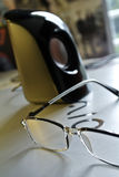Black Frame Eyeglass Beside Black and White Electric Kettle Royalty Free Stock Image
