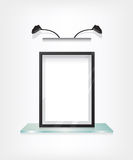 Black frame on glass shelf Royalty Free Stock Photography
