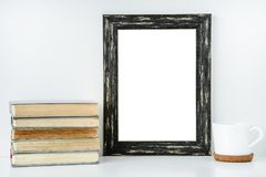 Black frame isolated with decorations from white cup and old boo royalty free stock images