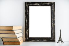 Black frame layout. Toy tower and old books near the frame on a. Black frame mockup, a place to work. Toy tower and old books near the frame on a white royalty free stock photography