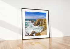 Black frame leaning in bright white interior with wooden floor mockup 3D rendering stock illustration