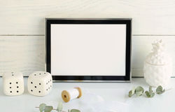 Black frame mockup with interior items. On light background. Copy space royalty free stock image