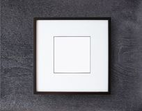 Black frame on wall. Black frame on wooden wall stock photos