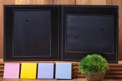 Black Frame on wood background Stock Photography