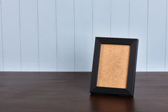 Black frame on a wooden table Stock Photo