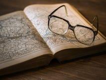 Black Framed Eyeglasses on Book Royalty Free Stock Images