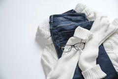 Black Framed Eyeglasses On White Jacket And Blue Denim Bottoms Stock Image