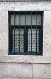 Black framed fenced window Royalty Free Stock Photo