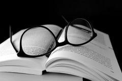 Black Framed Wayfarer Eyeglasses on Book Royalty Free Stock Photos
