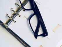 Black Framed Wayfarer Style Eyeglasses on White Surface Royalty Free Stock Photography