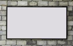 Black frames on brick wall Stock Photo