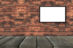 Black frames on old brick wall with black wooden perspective for Stock Photo