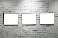 Black frames on white brick wall 2 Stock Photos