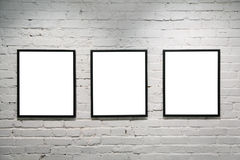 black frames on white brick wall 3 royalty free stock photography