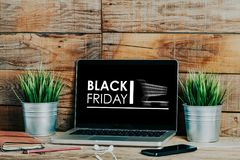 Black Friday advertisement in a laptop screen placed at the office. Stock Images