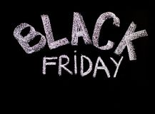 Black Friday advertisement handwritten with chalk on blackboard Royalty Free Stock Photo