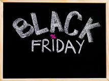Black Friday advertisement handwritten with chalk on wooden frame blackboard Royalty Free Stock Photos