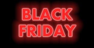 Black Friday assina dentro o vermelho imagens de stock