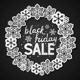 Black friday background with paper snowflakes Stock Images