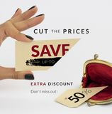 Black Friday banner. Female hand holding a cut price tag with opened vintage wallet below – cut piece below. On white background Royalty Free Stock Images