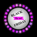 Black Friday banner. Festive sale poster with purple matte balls on a dark background and white circle in the center with sale text. Glowing Christmas lights Stock Photos