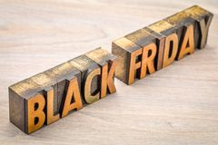 Black Friday banner in wood type. Black Friday banner  in vintage letterpress wood type blocks against grained wood Royalty Free Stock Photography