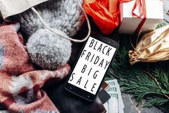 Black friday big sale. special christmas offer discount text on. Mobile phone screen message on seasonal rustic background with money cards wallet and bag with royalty free stock image