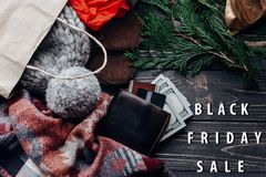 Black friday big sale special offer discount text message on sea. Sonal rustic background with money wallet and bag with presents. advertising concept Stock Images