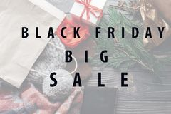 Black friday big sale special offer discount text message on sea. Sonal rustic background with money wallet and bag with presents. advertising concept Royalty Free Stock Images