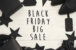 Black Friday big sale text sign, minimalistic flat lay. Special. Discount christmas offer. Stylish advertising message at black gift boxes, price tags on white royalty free stock images