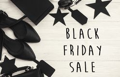 Black Friday big sale text sign, minimalistic flat lay. Special. Discount christmas offer. Stylish advertising message at black gift boxes, price tags on white stock photography